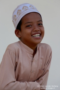 Boy cap and shirt front smile