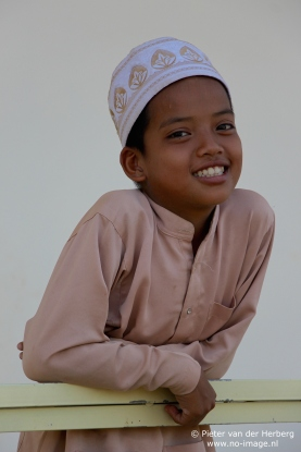 Boy cap and shirt sweet look in camera