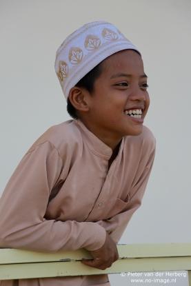 Boy cap shirt beautiful smil side