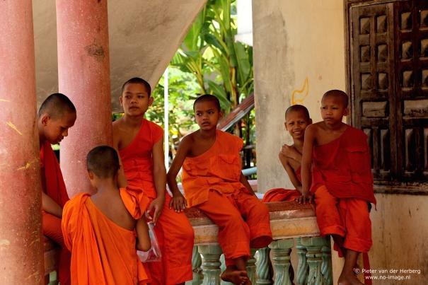 Monks sitting standing ballustrade