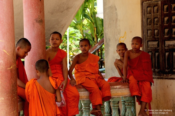 Monks sitting standing ballustrade