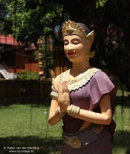 Pagoda statue folded hands purple side