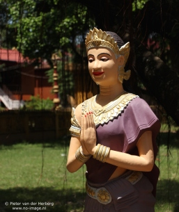 Pagoda statue folded hands purple side