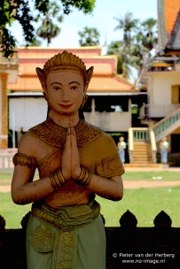 Pagoda statue hands folded front